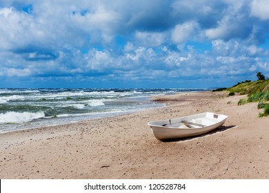 Panorama of the beautiful scenic view of storm Baltic sea with boat, Palanga