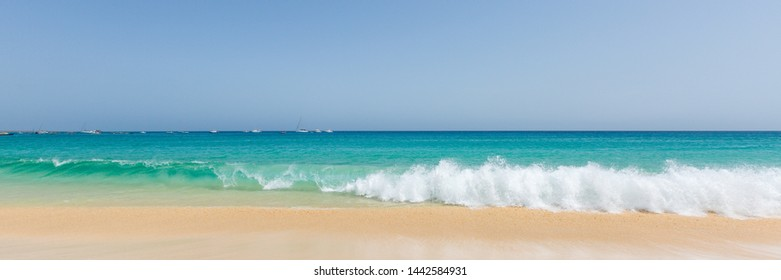 Panorama of beautiful and sunny seascape with gold sand and turquoise ocean at Sal island, Cape Verde, Cabo Verde