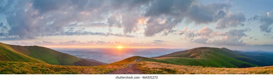 Panorama of a beautiful sunrise in the Carpathian mountains. Ridge Borzhava, Transcarpathia, Ukraine, Europe.