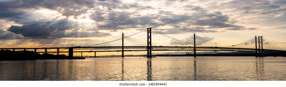 Panorama of beautiful sunset at The Forth road bridge and Queensferry crossing bridge in Edinburgh Scotland UK.