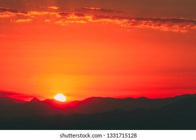 Panorama of Beautiful Sunset Sunrise Over Dark Mountain Silhouette
