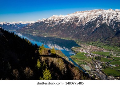 A panorama beautiful view of Interlaken town, Eiger, Mönch and Jungfrau mountains and of Lake Thun and Lake Brienz from Two Lakes Bridge viewing platform on Harder Kulm, Switzerland.