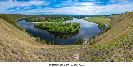 The panorama of the Belaya River from the height of the hill on its bank