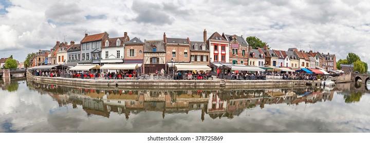 Panorama of Belu embankment with summer verandas of restaurants in Amiens, France