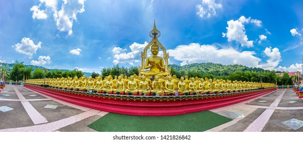 Panorama of Big golden Buddha statue among small 1,250 Buddha statue at Makha Bucha Buddhist memorial park built on the occasion of Great period, Buddha 2600 years at nakhon nayok province, Thailand