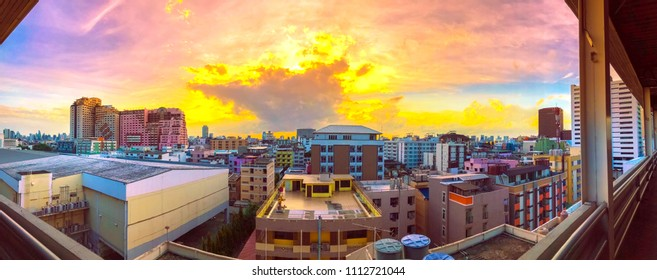 Panorama bird view over cityscape with sunset and clouds in the evening.Copy space.Bangkok.Pastel tone.