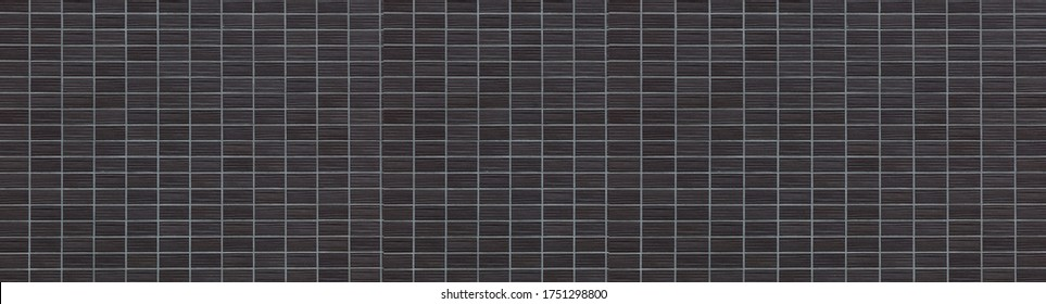 Panorama of Black brick tile wall background seamless and texture