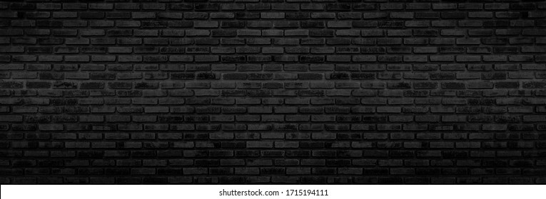 Panorama Black brick walls that are not plastered background and texture. The texture of the brick is black. Background of empty brick basement wall.