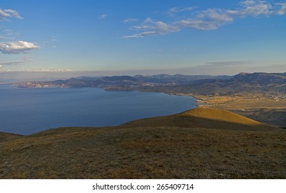 Panorama of the Black Sea coast. Crimea, view from the slope of Cape Meganom. Morning.
