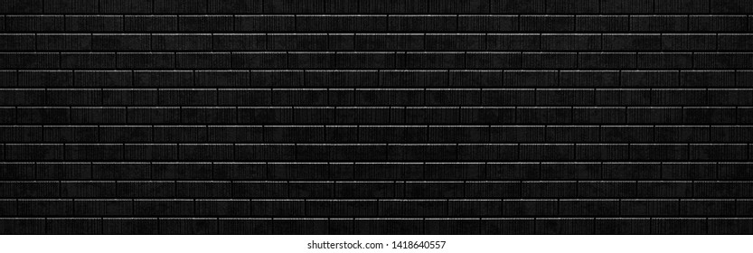 Panorama of Black stone block wall texture and background seamless