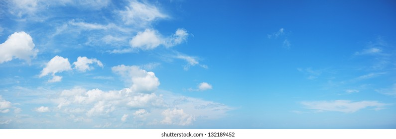 Panorama of a blue cloudy sky
