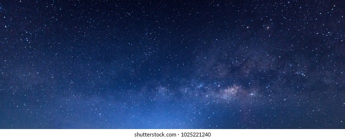Panorama blue night sky milky way and star on dark background.with noise and  grain.Photo by long exposure and select white balance.