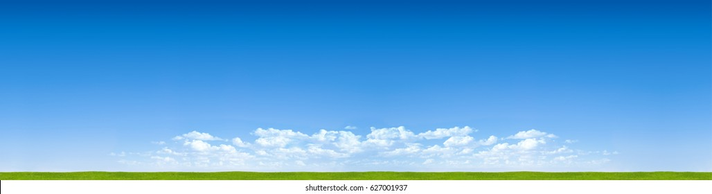 panorama blue sky horizon with clouds and grass