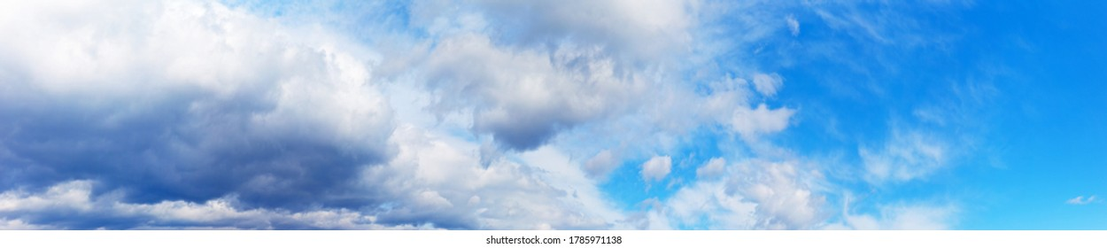 Panorama of a blue sky with impending thunderstorm clouds. Skyscape. Natural background. Weather, meteorological reports