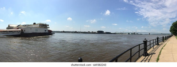 A panorama of a boat sailing on the Mississippi River in Davenport, IA