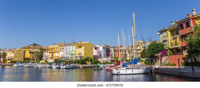 Panorama of boats and colorful houses of Port Saplaya in Valencia, Spain