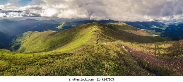 Panorama of Borzhava ridge of the Ukrainian Carpathian Mountains. Mount Velykyi Verch is at the background. Clouds above Carpathian Mountains.