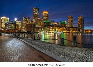 Panorama of Boston skyline from Fan Pier at the fantastic twilight time with smooth water river in boston, Massachusetts, USA downtown skyline,Architecture and building with tourist and travel concept