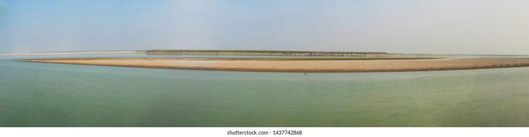 Panorama of the Brahmaputra riverbank.
