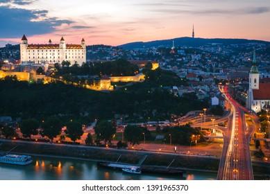Panorama of Bratislava city after sunset with beautiful pink sky