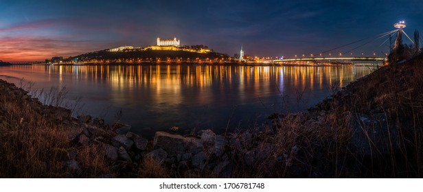 Panorama of Bratislava from the river Danube with castle bridge and old town