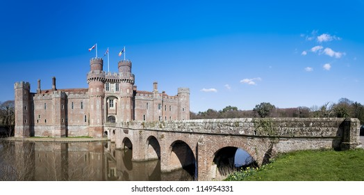 panorama of the bridge leading over moat to Herstmonceux Castle in the Sussex countryside of England