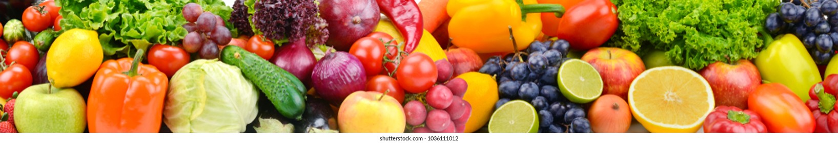 Panorama bright colorful vegetables and fruits. Food background.