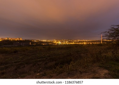 Panorama of Brno city in the night. Orange clouds over city. Long exposure, blurred clouds.
