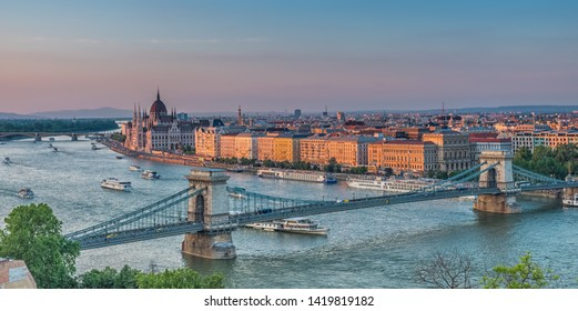 Panorama of Budapest at sunset. Hungarian landmarks: Chain Bridge, Parliament and Danube river in Budapest.