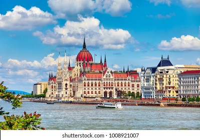 Panorama with building of Hungarian parliament at Danube river in Budapest city, Hungary. Blue sky with clouds.
