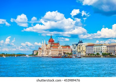 Panorama with building of hungarian parliament at danube river in budapest city hungary blue sky clouds