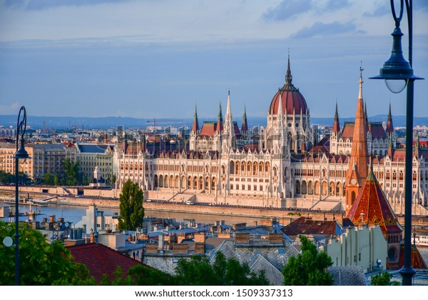 Panorama with building of Hungarian parliament at Danube river in Budapest city, Hungary. Blue sky clouds.