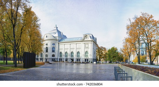 Panorama of the building of the Museum of Foreign Art of Latvia in Riga in the city's autumn park with yellow leaves