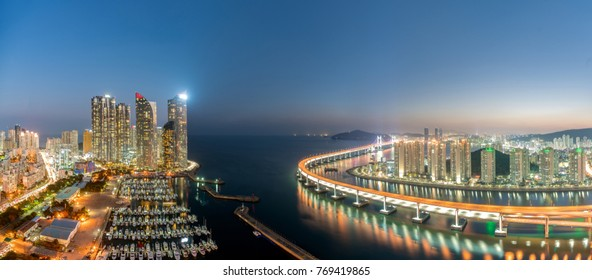 Panorama of Busan city skyline view at Haeundae district, Gwangalli Beach with yacht pier at Busan, South Korea.