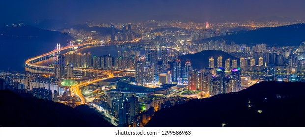 Panorama of Busan cityscape with skyscrapers and Gwangan Bridge illuminated at night. Busan. South Korea