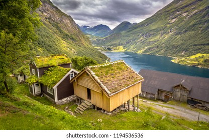 Panorama of Cabins with traditional sod roof in Geirangerfjord in More og Romsdal province Norway