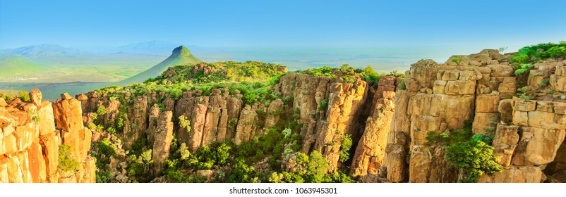 Panorama of Camdeboo National Park Valley of Desolation, Karoo in Eastern Cape near town of Graaff-Reinet, South Africa. Summer season. Blue sky. Banner with copy space.