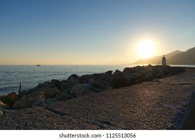 Panorama of Camogli, pier and lighthouse - Liguria - Italy