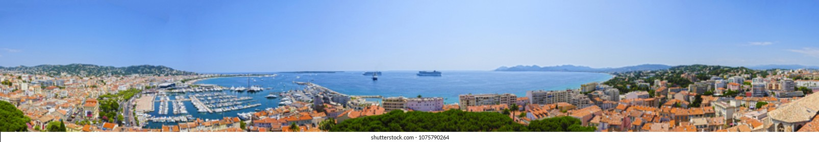 Panorama of Cannes in France with marina, cruise ships, palace of festivals, Croisette, city and highland