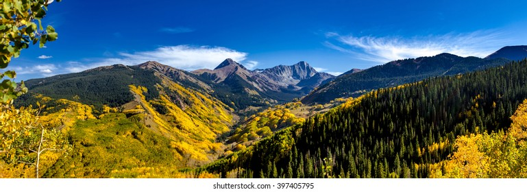 Panorama of Capitol Peak mountain valley in full fall color near Aspen Colorado