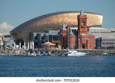 Panorama of Cardiff Bay, photographed on a sunny day in June 2017. The sun is reflecting off the copper roof of the Wales Millennium Centre.