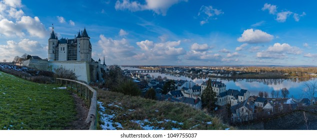 A panorama of the Castle of Saumur taken from a nearby grass field.