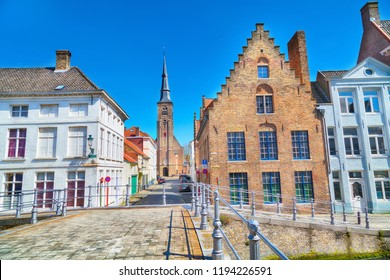 Panorama with cathedral tower and traditional houses in popular belgian destination, Bruges, Belguim