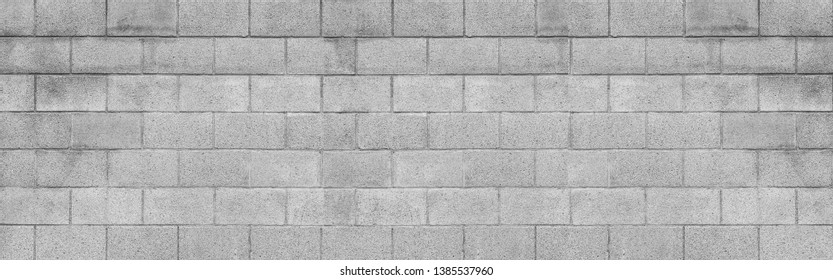 Panorama of cement block wall texture and background