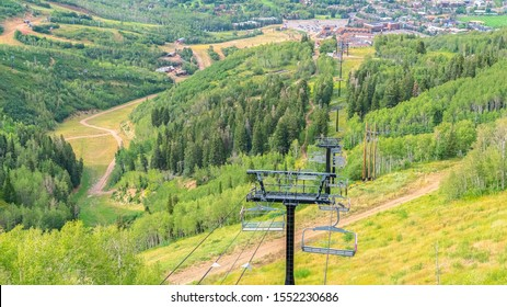 Panorama Chairlifts with amazing view of ski resort blanketed in greenery at off season