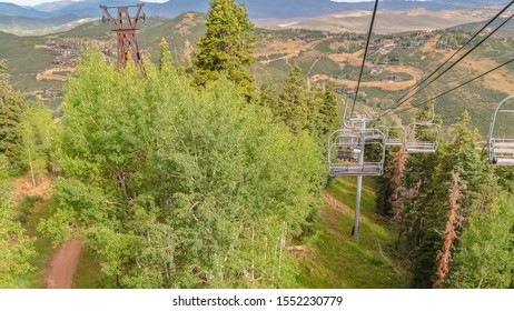 Panorama Chairlifts over mountain covered with greenery during off season in Park City