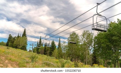 Panorama Chairlifts in Park City with a scenic aerial view of greenery during off season