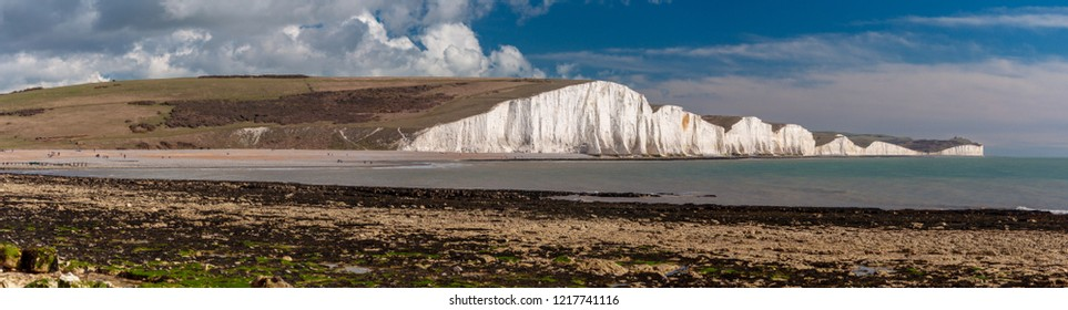 Panorama of chalk cliffs known as the Seven Sisters, from the beach at Hope Gap