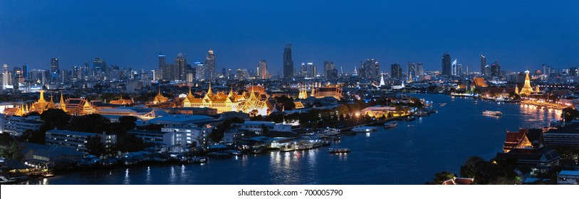 Panorama of Chao Praya River in Bangkok city, Thailand in night. With view of Grand Palace and Emerald Buddha Temple.