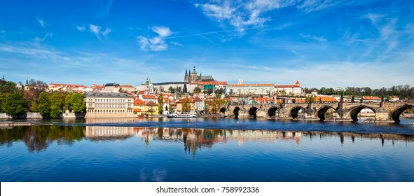 Panorama of Charles bridge over Vltava river and Gradchany (Prague Castle) and St. Vitus Cathedral. Czech Republic